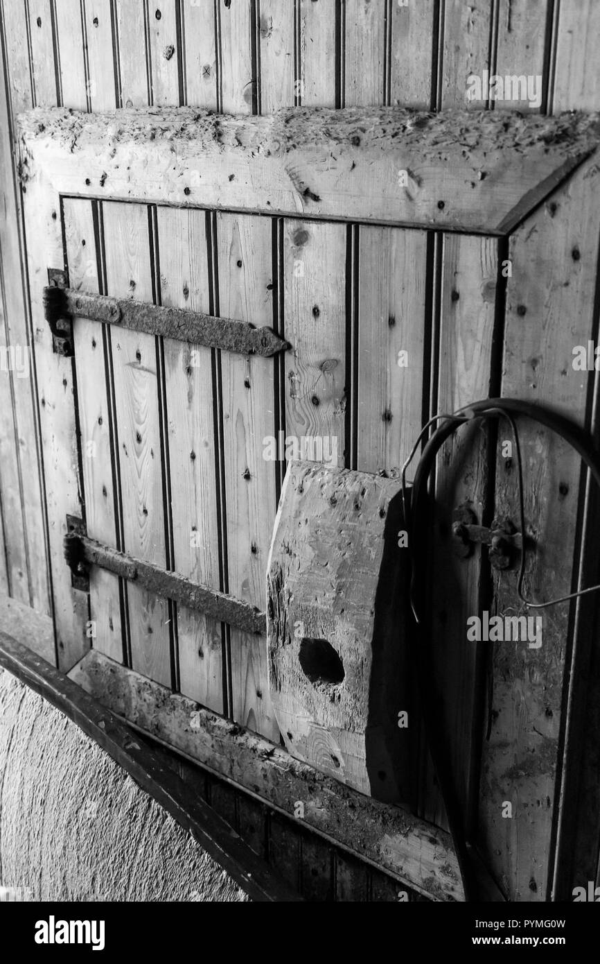 Rustic door or shute in an old Swedish farm in northern Sweden - Stock Image