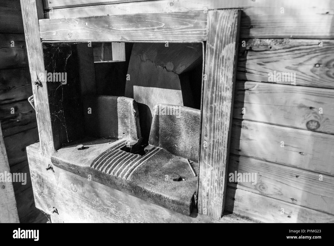 Antique wood splitter or chopper in an old Swedish farm in northern Sweden - Stock Image
