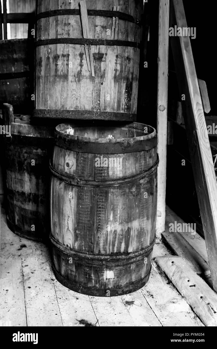 Rustic old oak wooden barrels in an old Swedish farm in northern Sweden - Stock Image