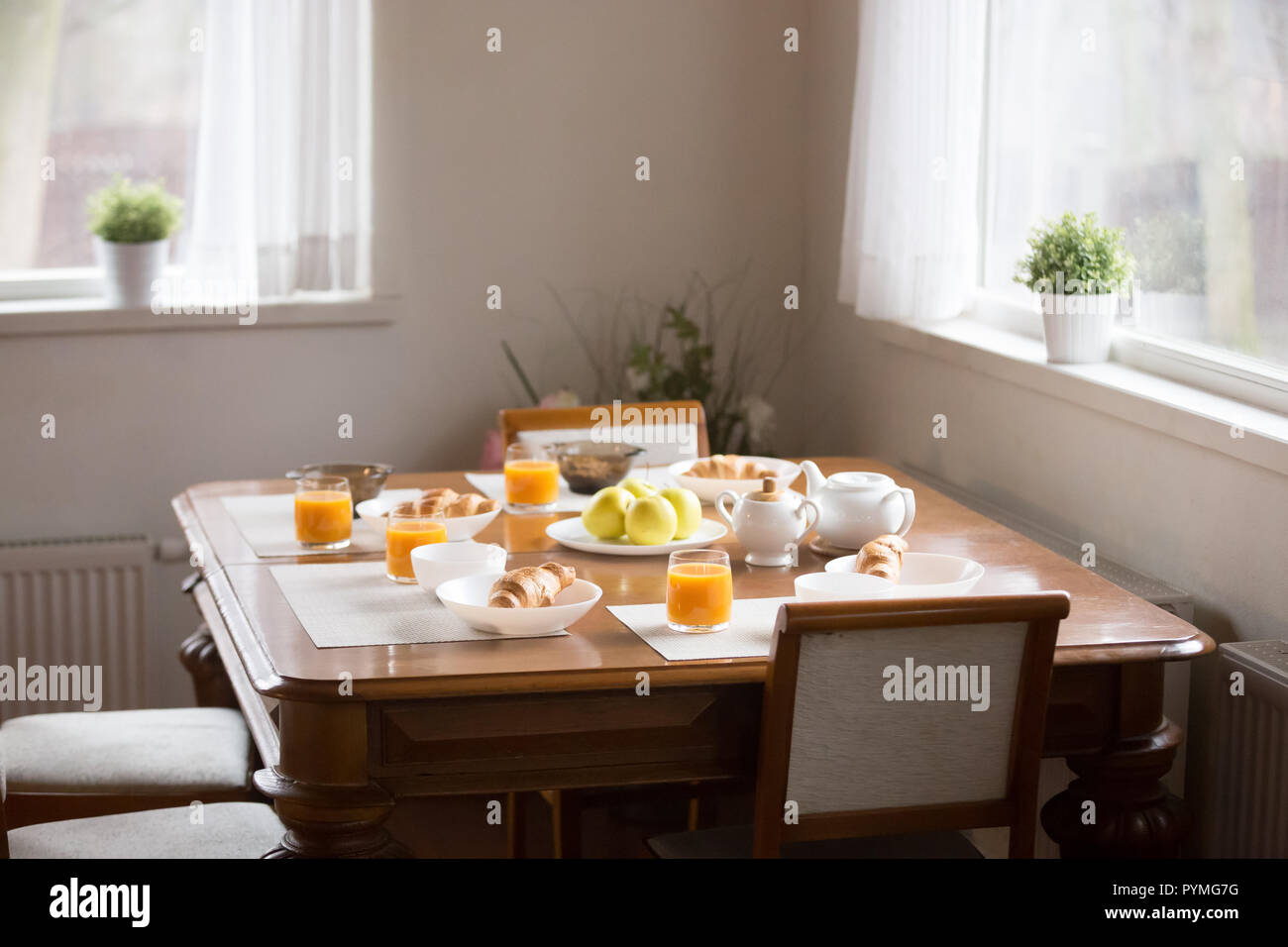 Breakfast is served at the dinner table - Stock Image