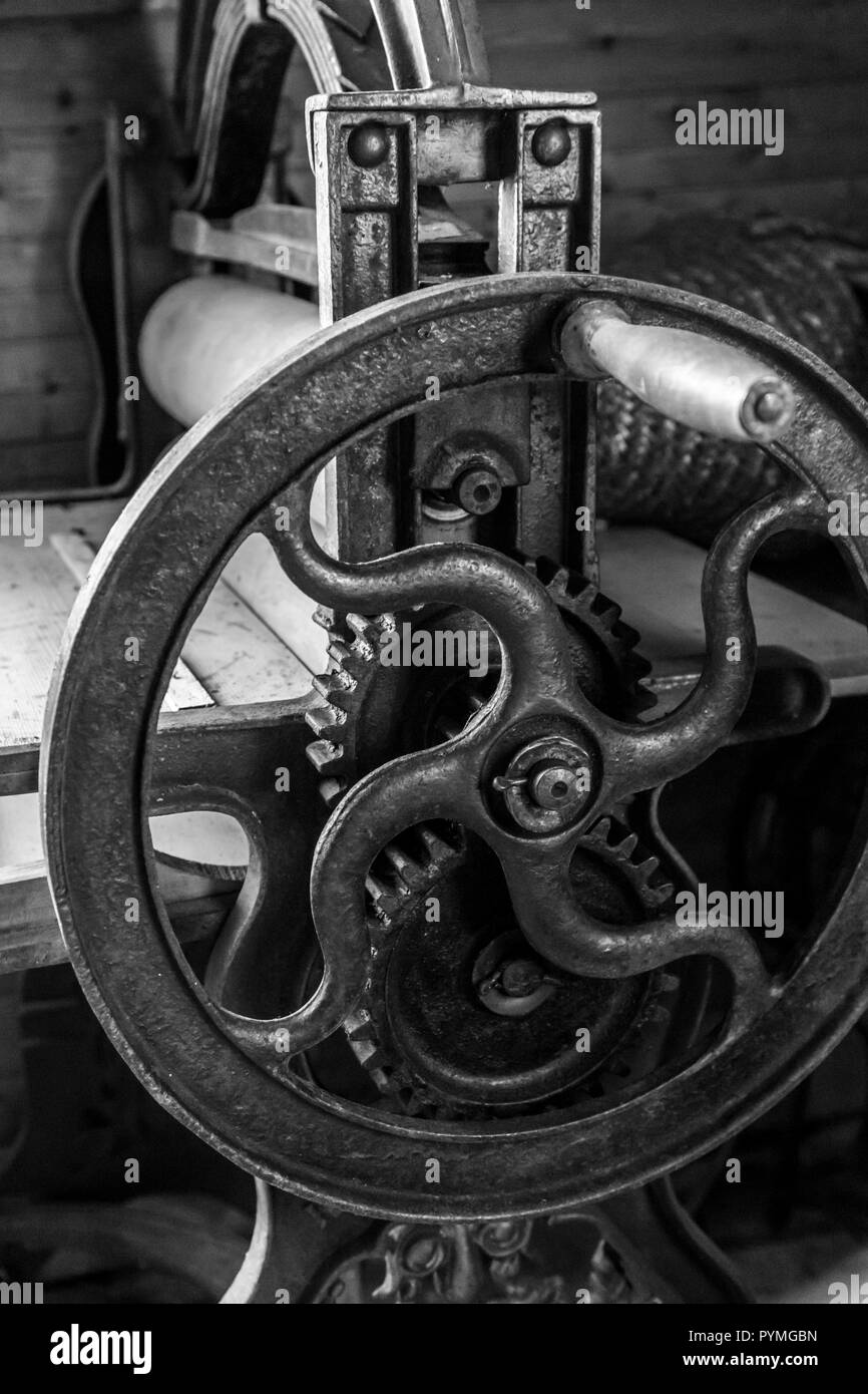 Antique iron metal press in an old Swedish farm in northern Sweden - Stock Image
