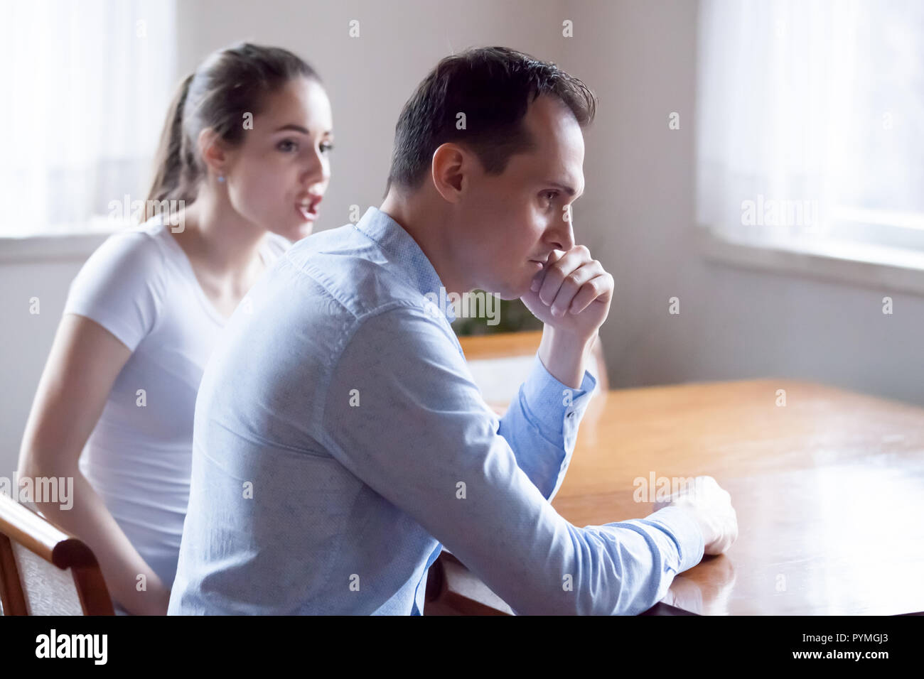 Indignant angry woman talking arguing with husband - Stock Image