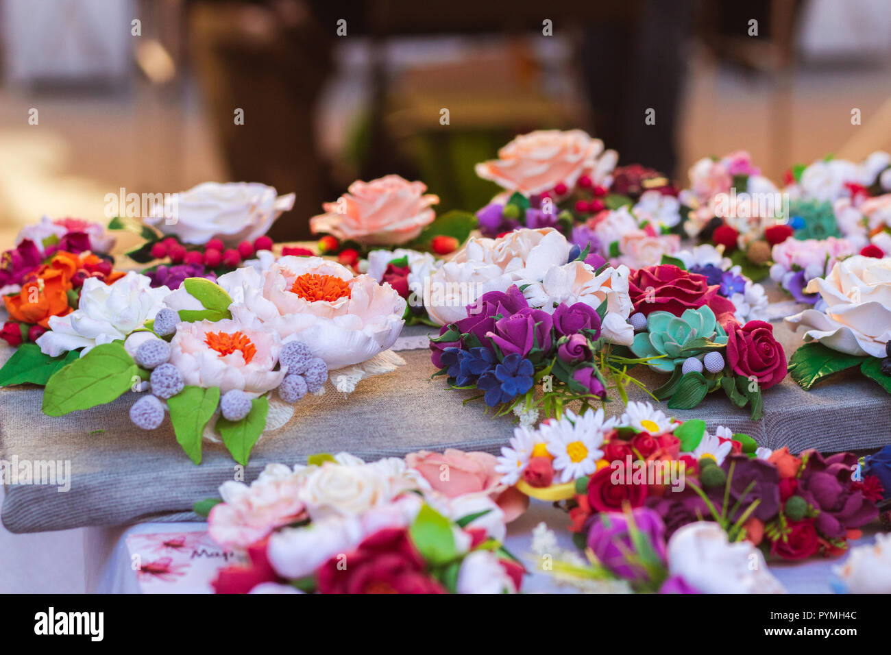 A large number of colorful artificial flowers - Stock Image