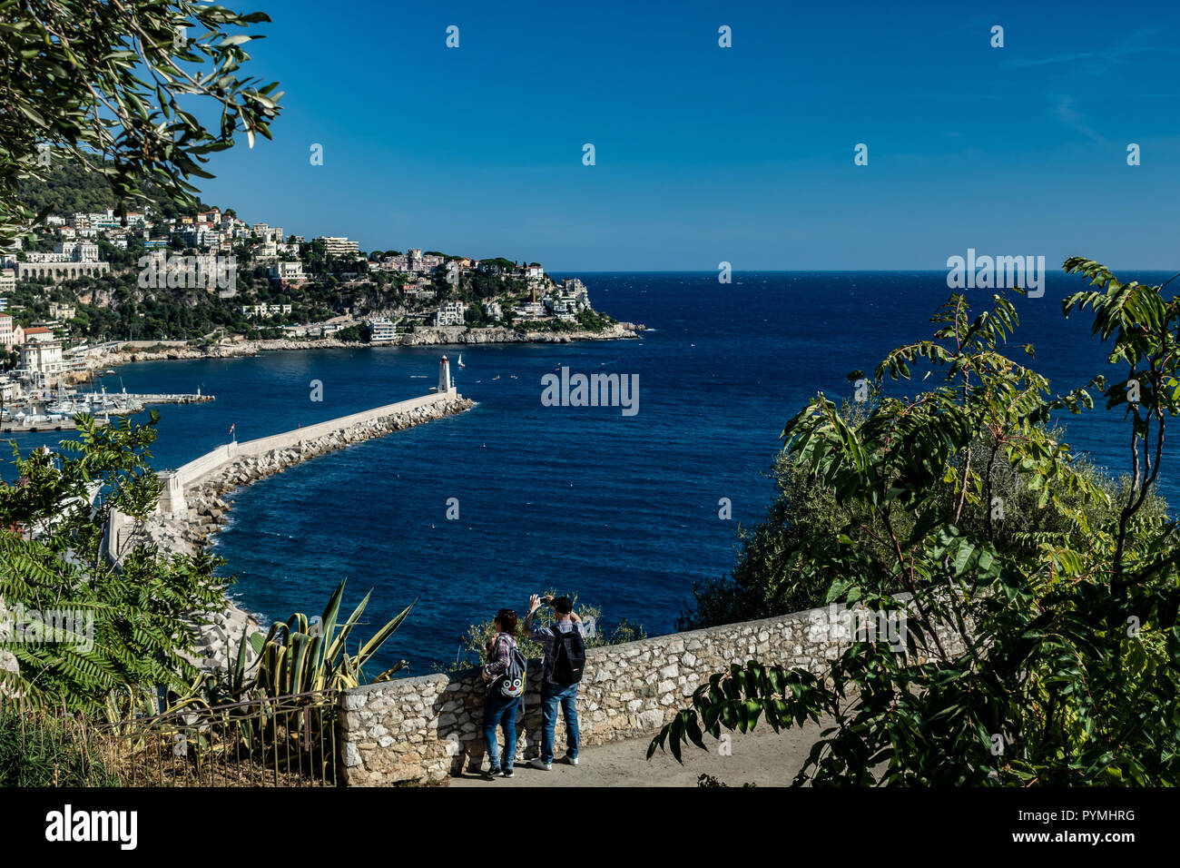 Tourists overlooking lighthouse bay Nice Cote D´azur France - Stock Image