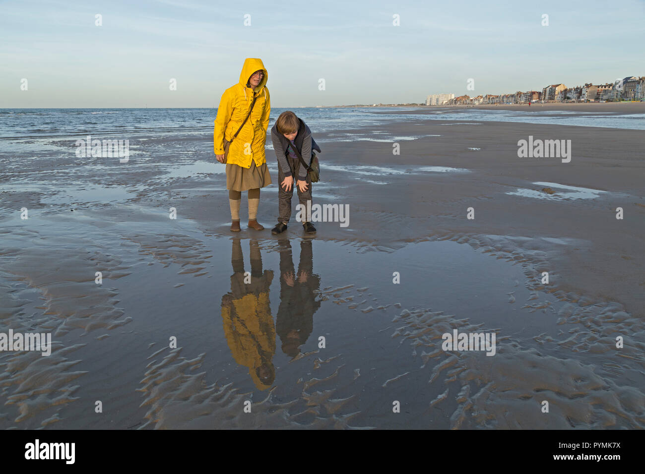 mother and son at the beach, Dunkirk, France - Stock Image