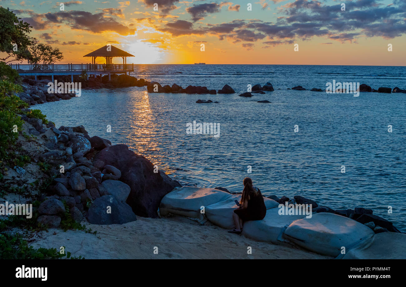 Balaclava, Mauritius - unidentified guests enjoy the sunset over the Westin Turtle Bay Resort and Spa on the west coast of the island - Stock Image