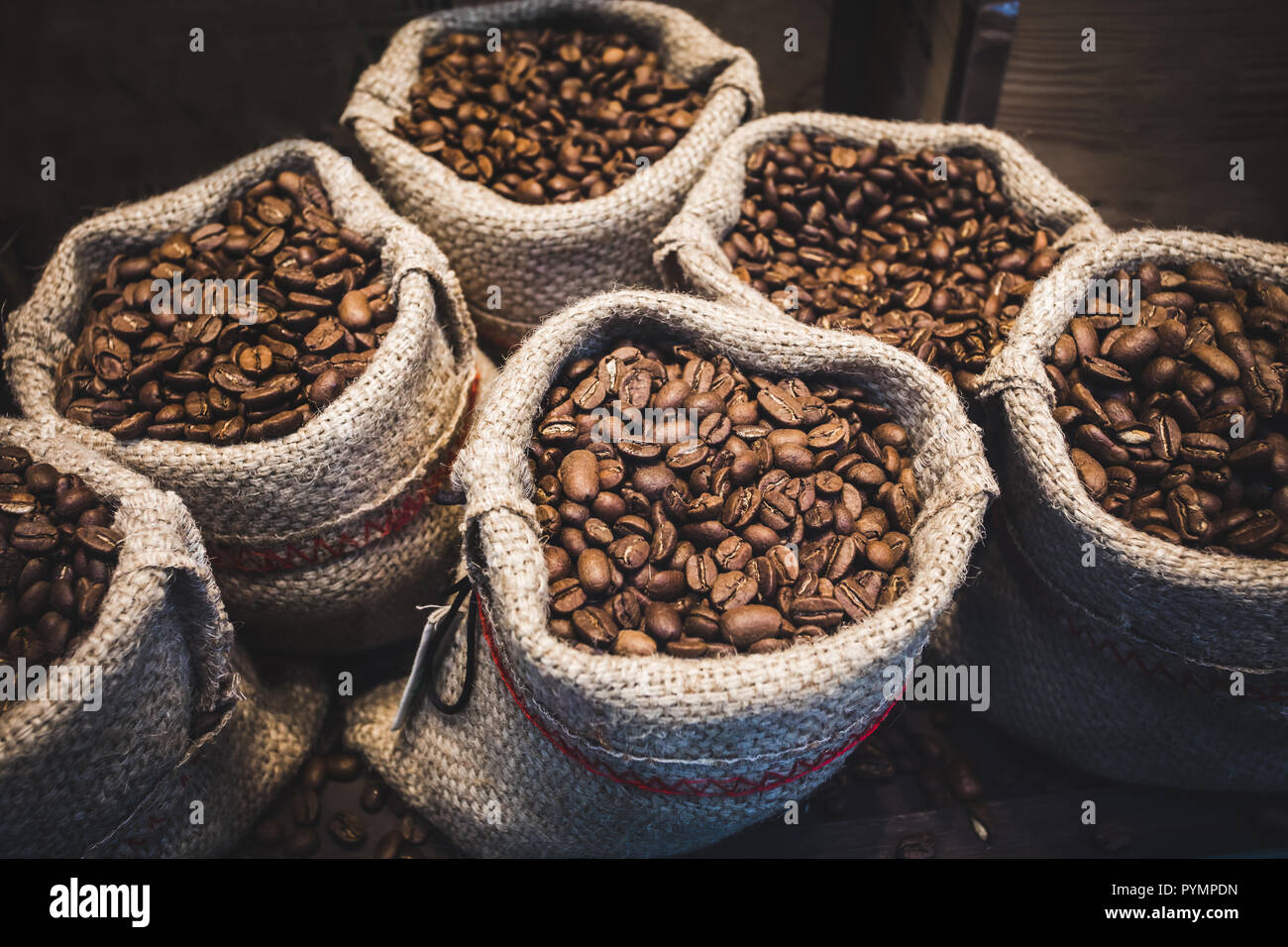 Coffee beans in bags. Fresh coffee beans background. - Stock Image