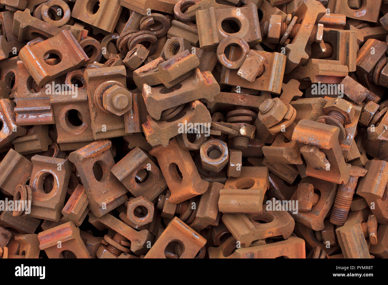 Rusty train track nuts, bolts, washers and clasps Stock