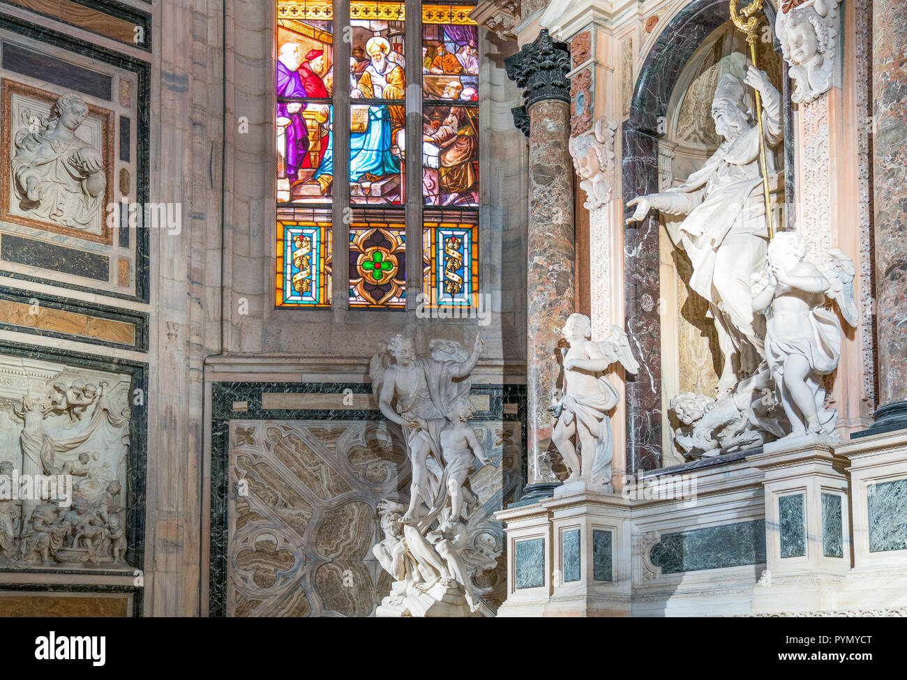 Milan, Italy, The interior of the Duomo Cathedral, the sculptural group of San Giovanni Bosco, by Vincenzo Buzzi - Stock Image