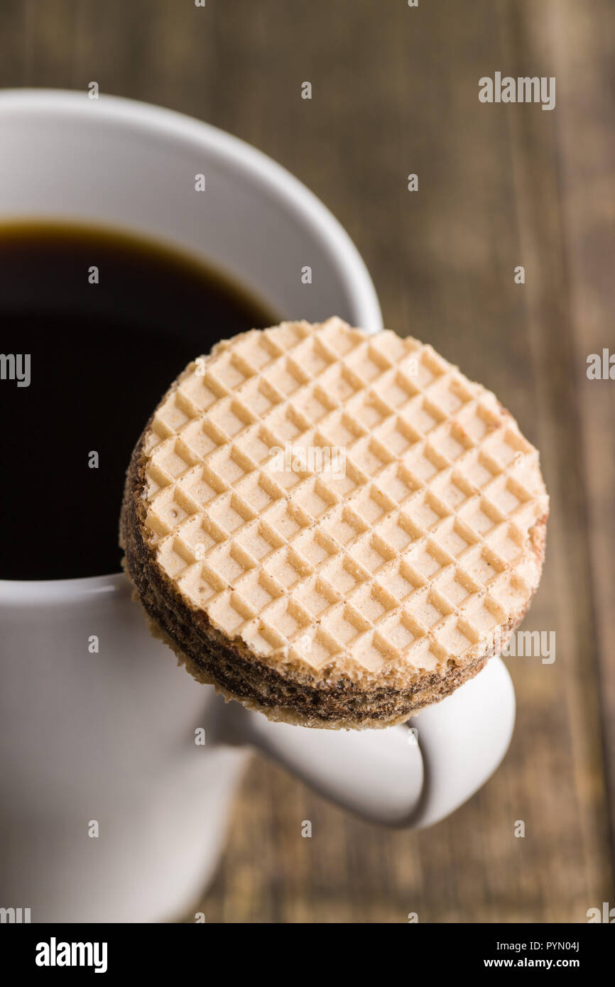 Sweet chocolate wafer biscuits and coffee cup. - Stock Image