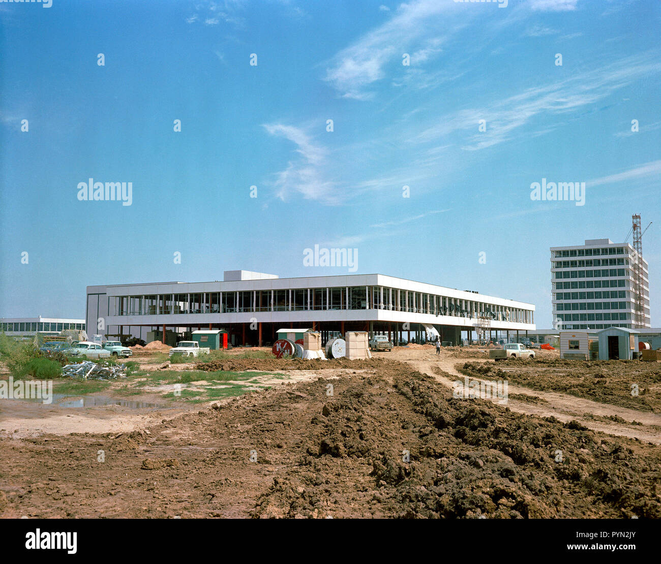 (25 Sept. 1963) --- This easterly view documents early construction of the Manned Spacecraft Center in September of 1963.  The Avionics Systems Laboratory (Building 16) is in the foreground and the Project Management Building is see in the right background. - Stock Image