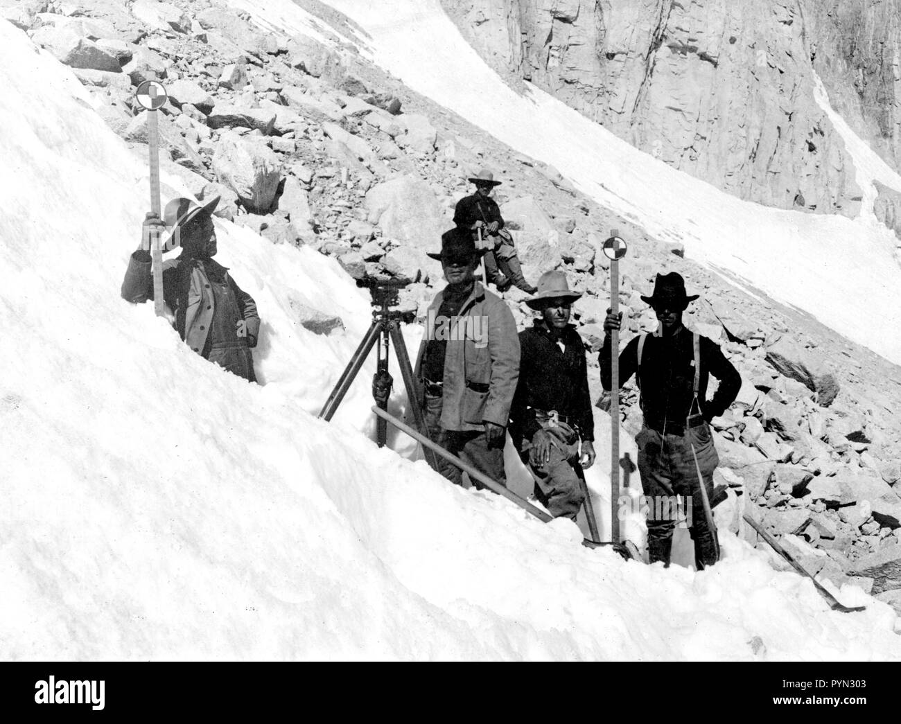 In this photo, taken in August 1905, we see a USGS topographic leveling party, headed by R.A. Farmer on the slopes of Mount Whitney, California - Stock Image