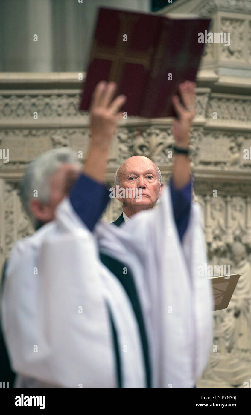 Apollo 11 command module pilot Michael Collins is framed by the upraised Bible held by the Rev. Gina Gilland Campbell during a memorial service celebrating the life of Neil Armstrong at the Washington National Cathedral, Thursday, Sept. 13, 2012.  (NASA/Bill Ingalls) - Stock Image