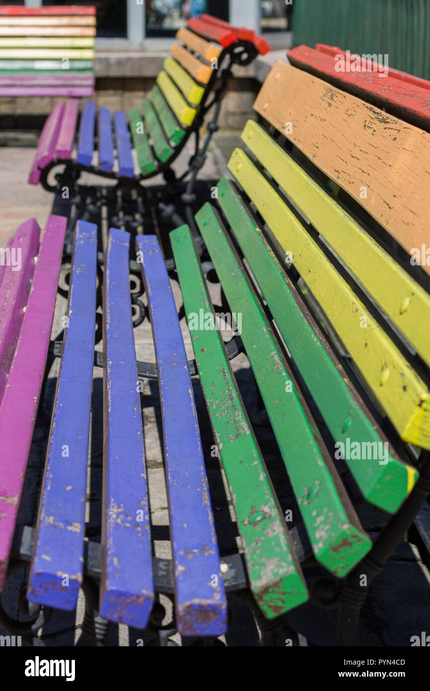 Oviedo, Asturias, Spain. Benches painted with the LGTBI flag in Escandalera square. - Stock Image
