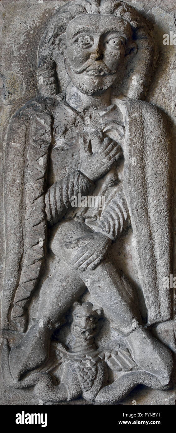 Relief of a warrior and of a drake, dating from the 12th century, In the Museum of Ancient Art in the Castello Sforzesco - Sforza Castle in Milan Italy - Stock Image