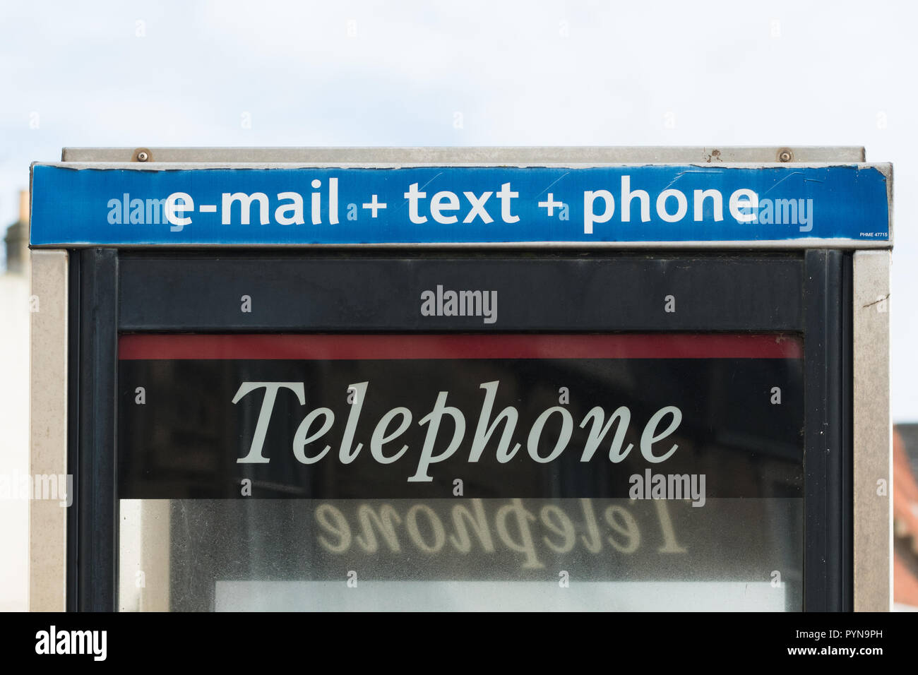 e-mail text phone sign above uk telephone box - Stock Image