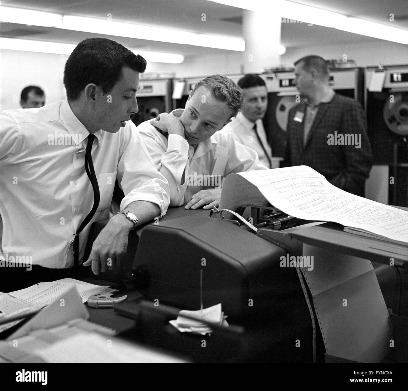 This archival image shows engineers at NASA's Jet Propulsion Laboratory looking at data related to the Venus flyby of Mariner 2 on Dec. 14, 1962. This was the first successful flyby of another planet. - Stock Image