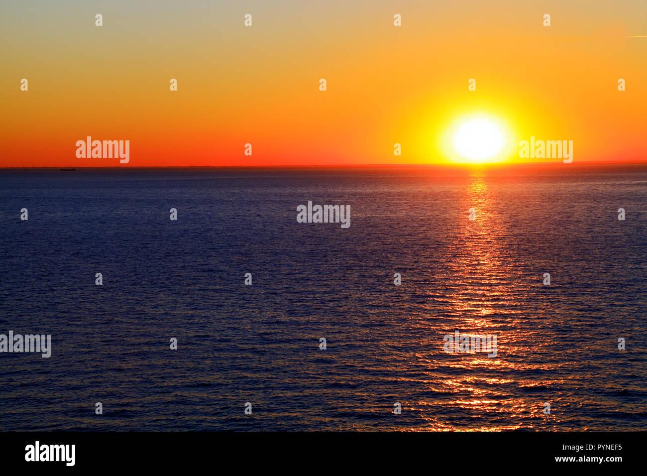 Sunset, sea, red sky, The Wash, North Sea, west facing coast, Hunstanton, Norfolk, UK, coasts - Stock Image