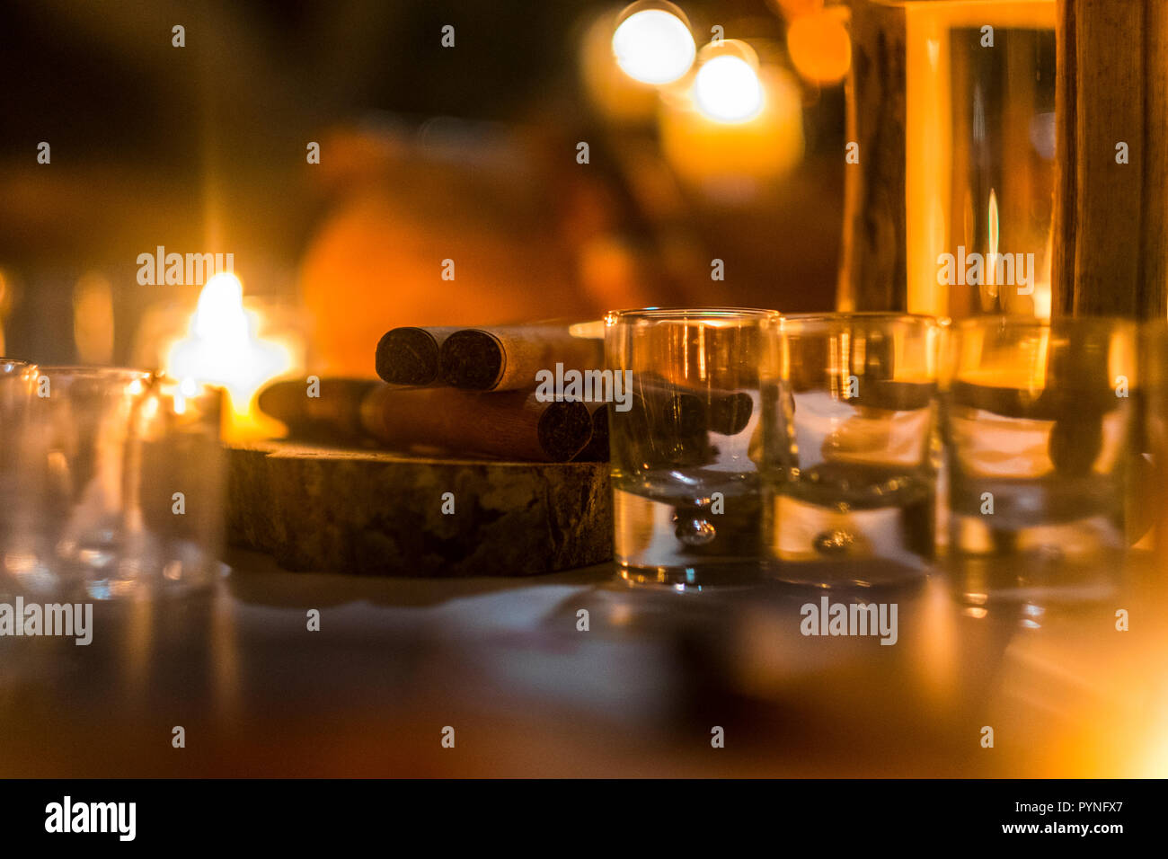 Cigar and rhum rum to end the night in friednship with men's things related. Bokeh and defocused image for conceptual mood about males Stock Photo