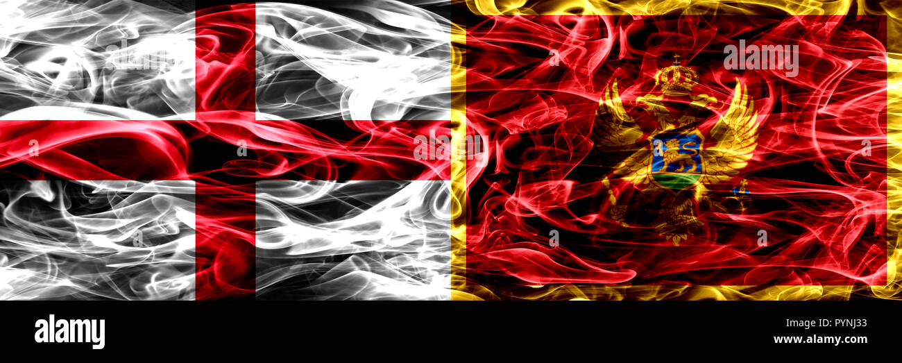 England vs Montenegro, Montenegrin smoke flags placed side by side. Thick colored silky smoke flags of English and Montenegro, Montenegrin Stock Photo