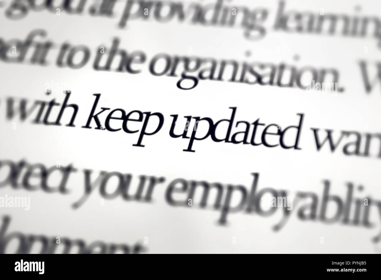 The word Keep Updated with lens blur - Stock Image