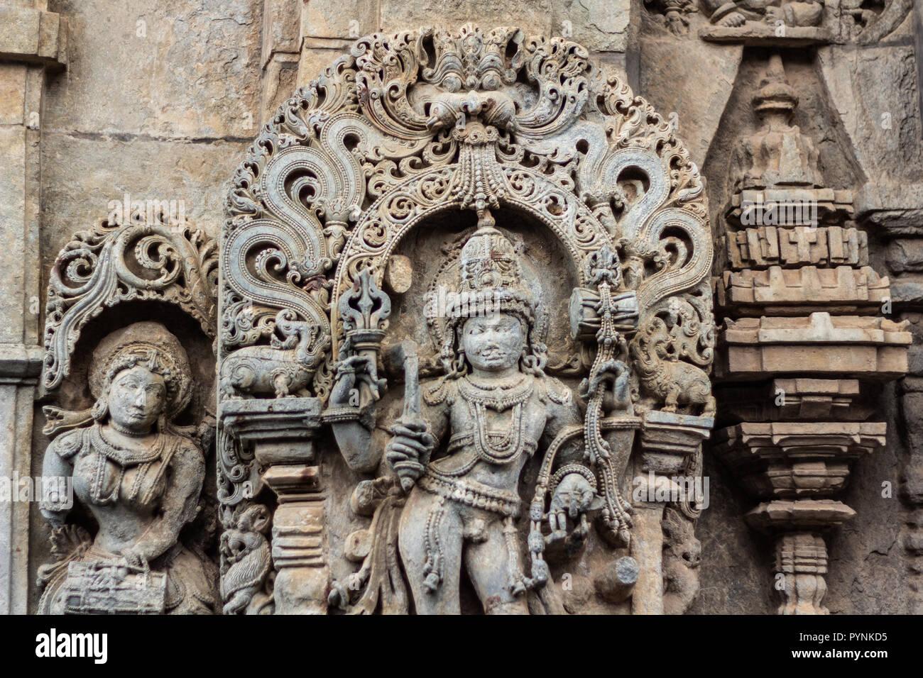 Intricate carvings of Hindu deities and Puranic stories in Belur and Halebid temple premise. Belur, Karnataka, India. - Stock Image