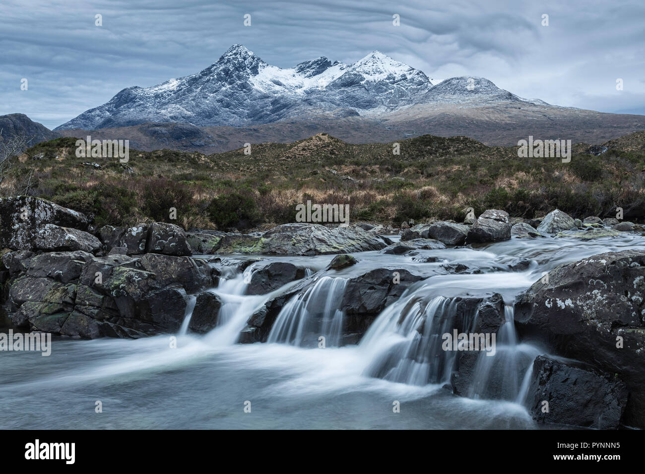 Waterfall with the Black Cuillin mountain, Sligachan, Isle of Skye, Scotland - Stock Image