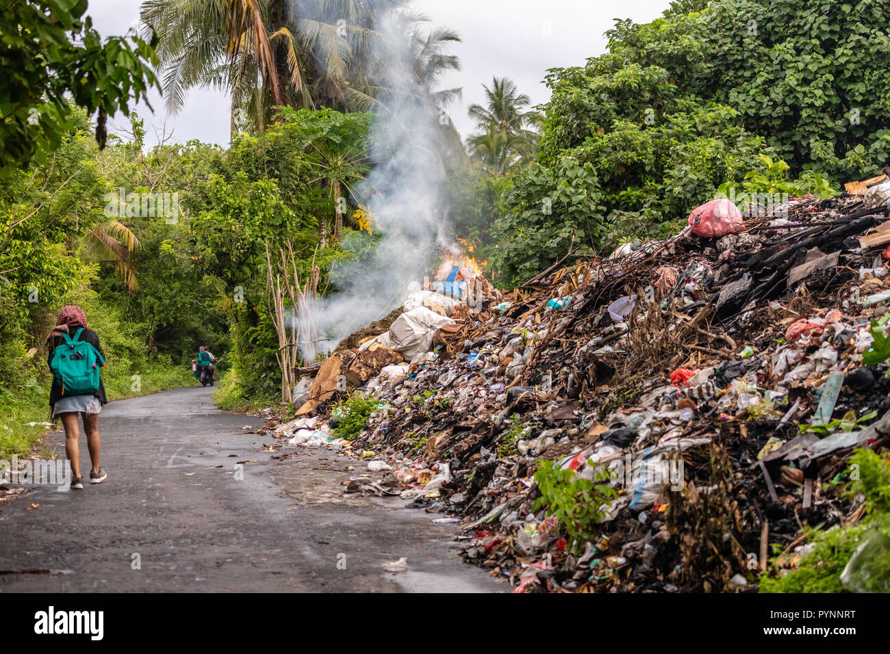 Tons of industrial rubbish burning along the road in the Banda Neira island, Indonesia Stock Photo