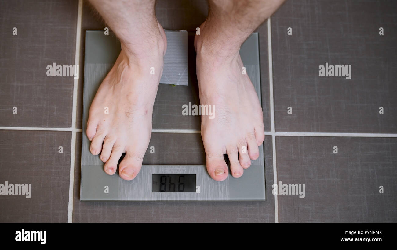 Male Feet On Glscales Menst Body Weight Close Up Man Standing On Scales Top Down View