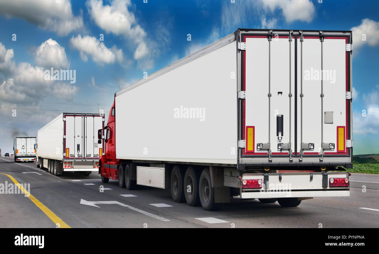 Container on the big highway. transport loads. Heavy traffic freight trailers on the highway. Cargo transportation - Stock Image