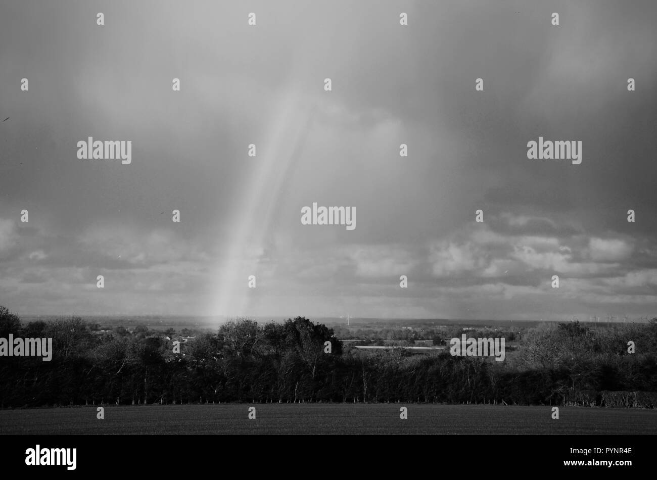 Black and white rainbow over Lincolnshire Wolds, England, UK - Stock Image