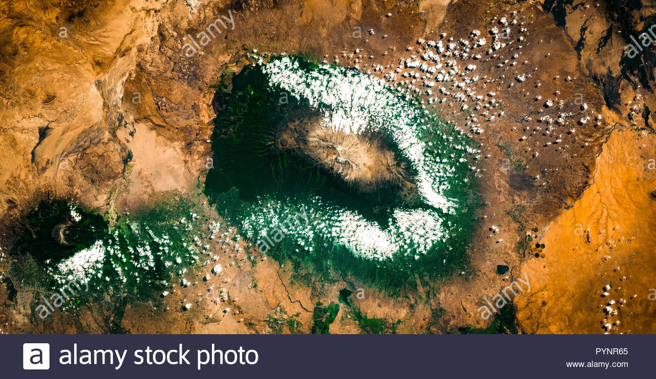 High resolution satellite image of Mount Kilimanjaro from above with few clouds, Tanzania, Africa, contains modified Copernicus Sentinel data [2018] - Stock Image