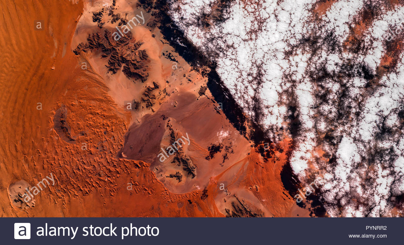 igh resolution satellite image of cloud boundary in Namib desert from above, Namibia, Africa, aerial, contains modified Copernicus Sentinel data[2018] Stock Photo