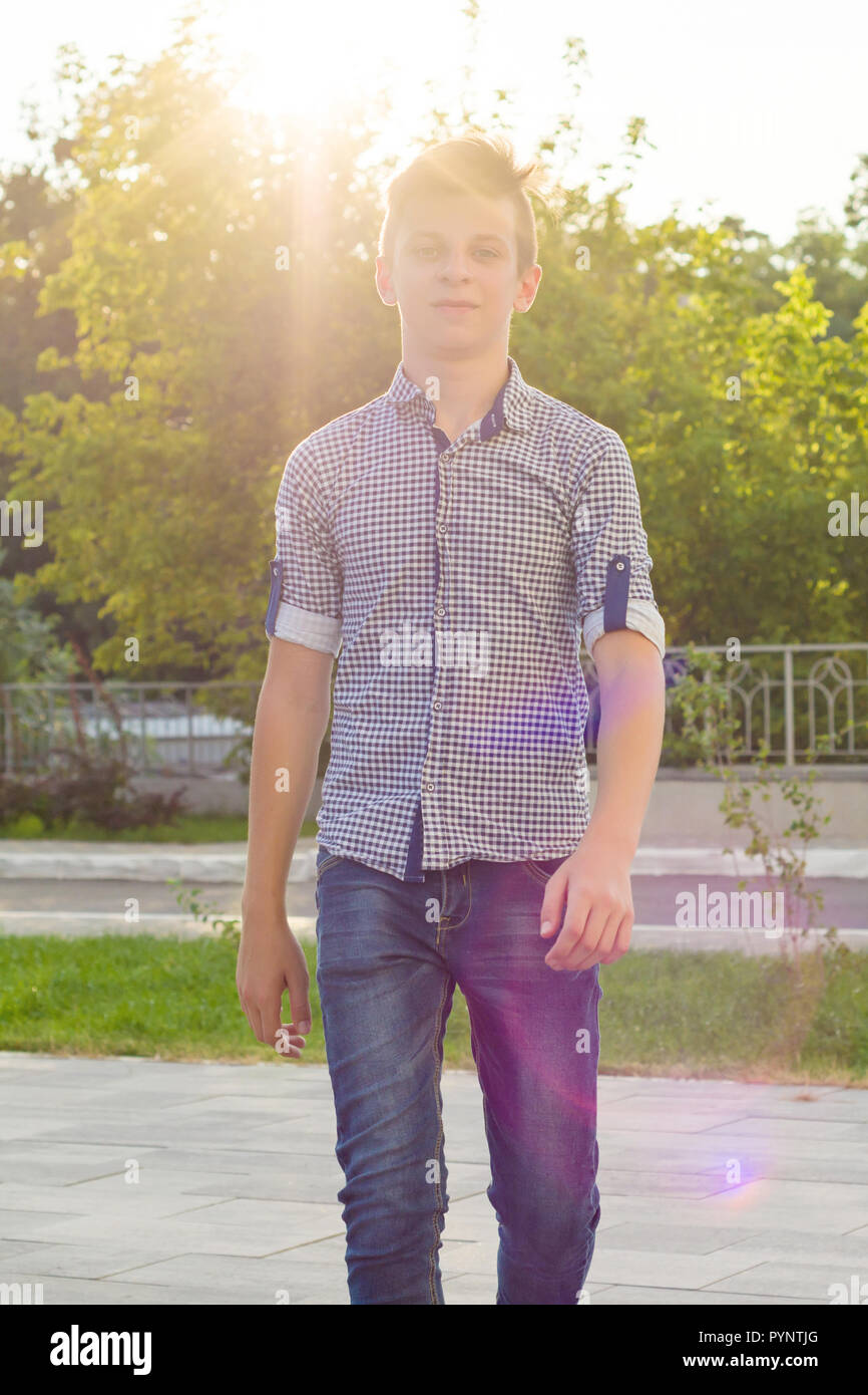 Outdoor portrait of teenage boy 14, 15 years old. Urban background. - Stock Image