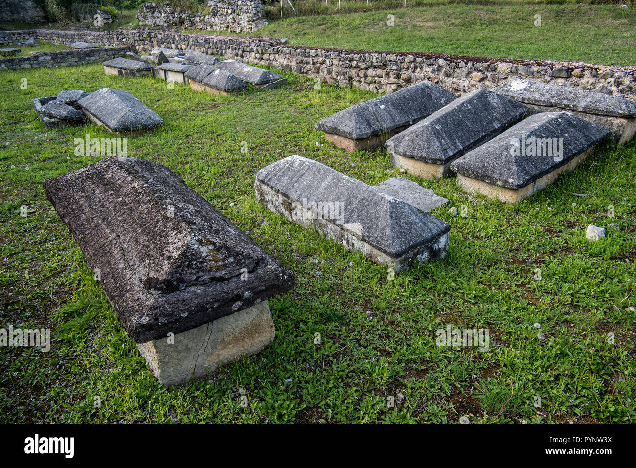 Sarcophagi among remains of the 5th century Early Christianity / Early Church basilica at Saint-Bertrand-de-Comminges, Haute-Garonne, Pyrenees, France - Stock Image