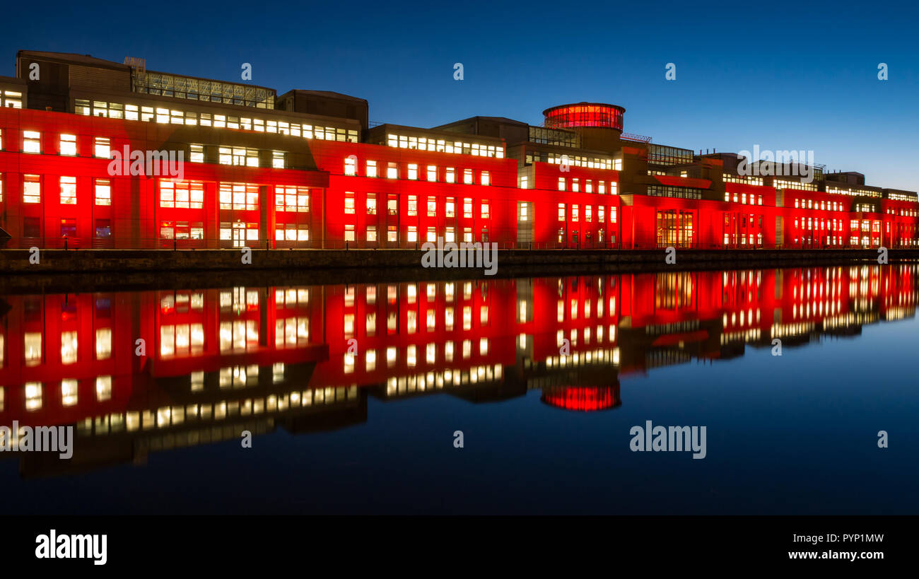 Leith, Edinburgh, Scotland, United Kingdom, 29th October 2018. Poppy Scotland Light Up Red: Scottish Government building at Victoria Quay lights up red for the Scottish Poppy Appeal in the run up to Remembrance Day and to mark the Armistice centenary for the Scottish Poppy Appeal - Stock Image