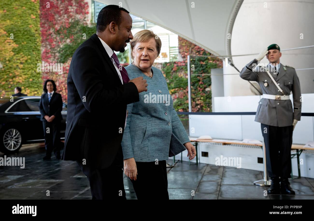 Berlin, Germany. 30th Oct, 2018. Chancellor Angela Merkel (CDU) receives Abiy Ahmed Ali, Prime Minister of the Democratic Federal Republic of Ethiopia, in front of the Federal Chancellery for the Africa Summit. This is where eleven heads of state and government come to Berlin for the summit meeting. It is about an initiative for more private investment in Africa, which Merkel launched last year as President of the Group of Leading Economic Powers (G20). Credit: Bernd von Jutrczenka/dpa/Alamy Live News - Stock Image