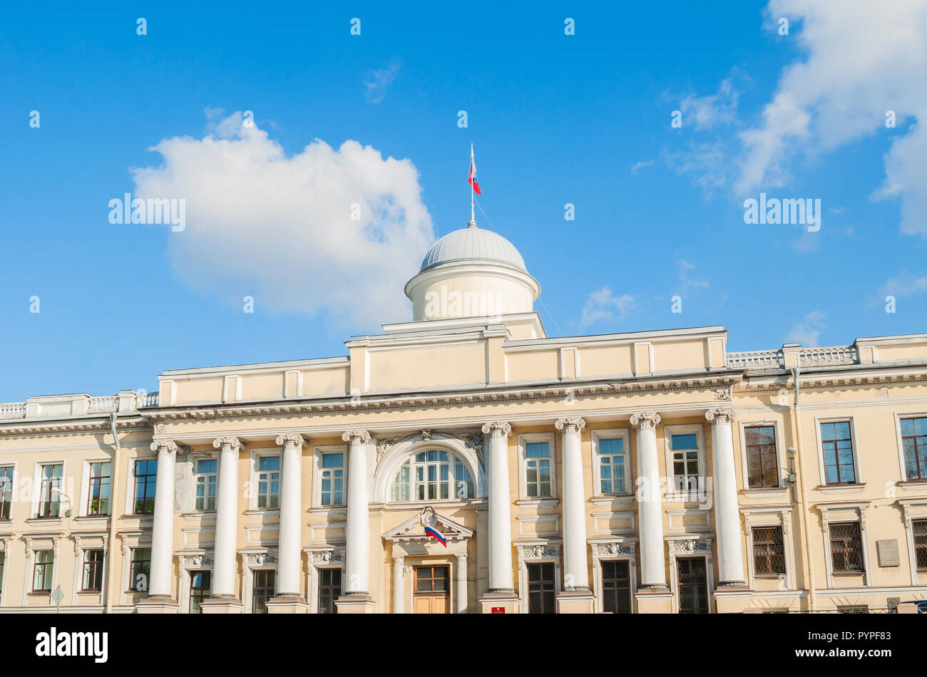 Leningrad Regional Court building on the Fontanka River in Saint Petersburg, Russia - closeup facade view with Russian flag on the roof flagpole - Stock Image