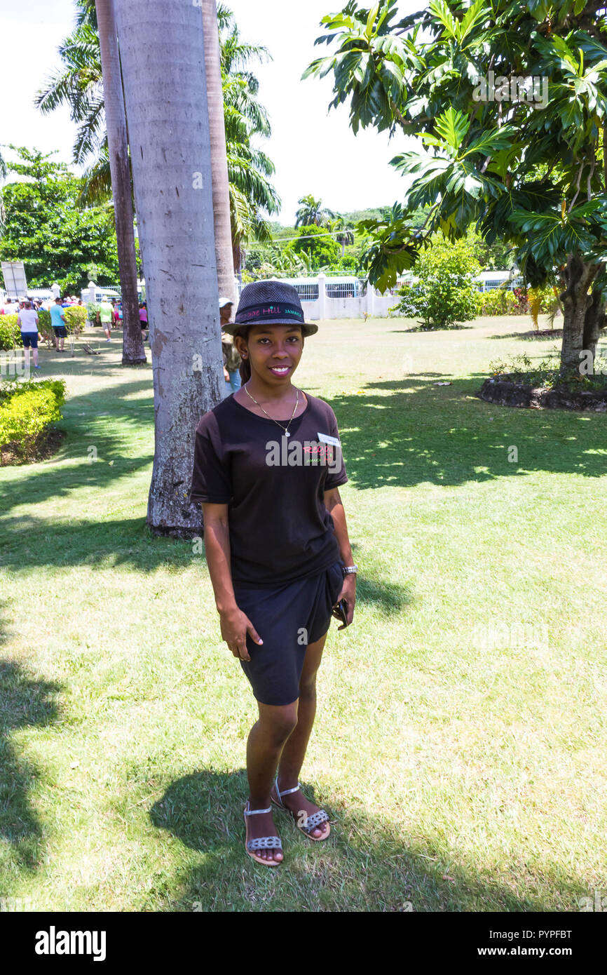 Falmouth, Jamaica - May 02, 2018: Female tour guide standing at park at Falmouth, Jamaica on May 02, 2018 - Stock Image