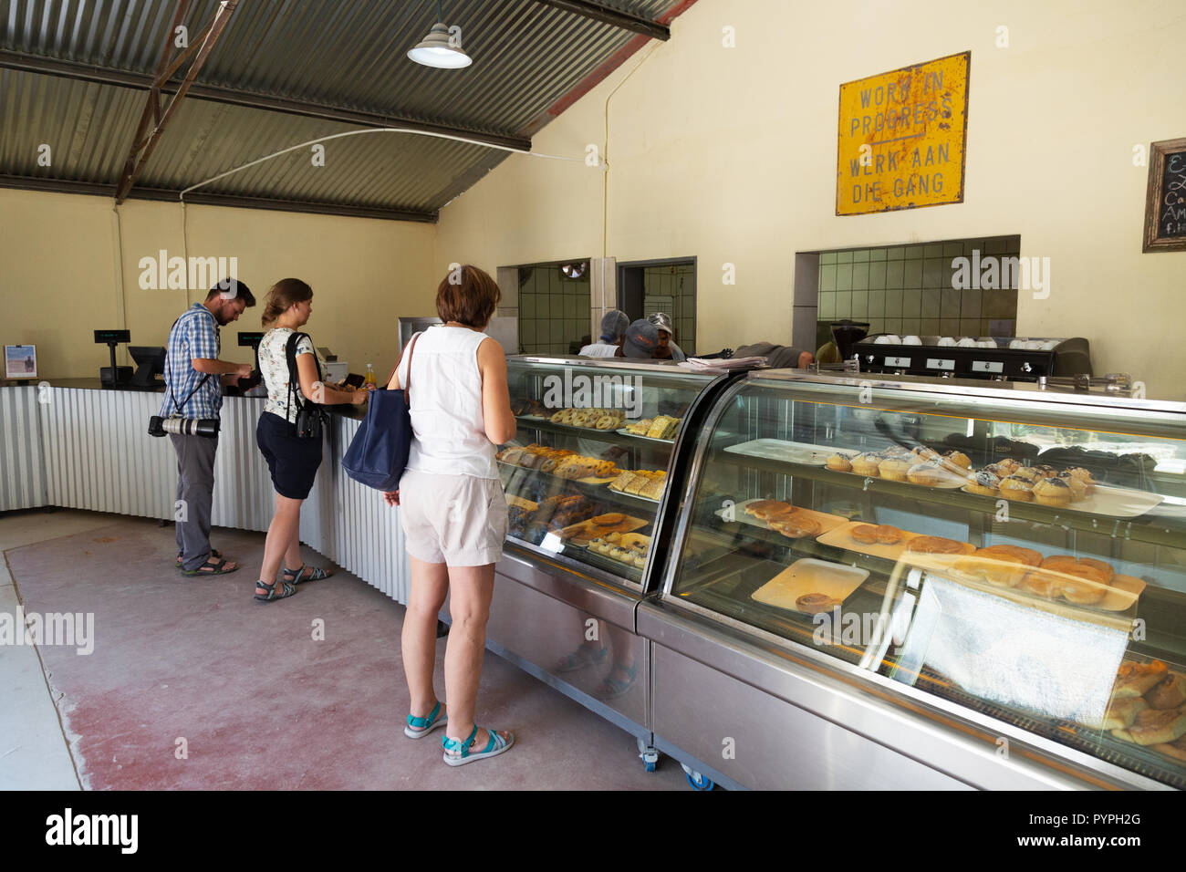 Namibia tourists queuing for food and drink, Mcgregor's bakery, Solitaire, Namibia Africa - Stock Image