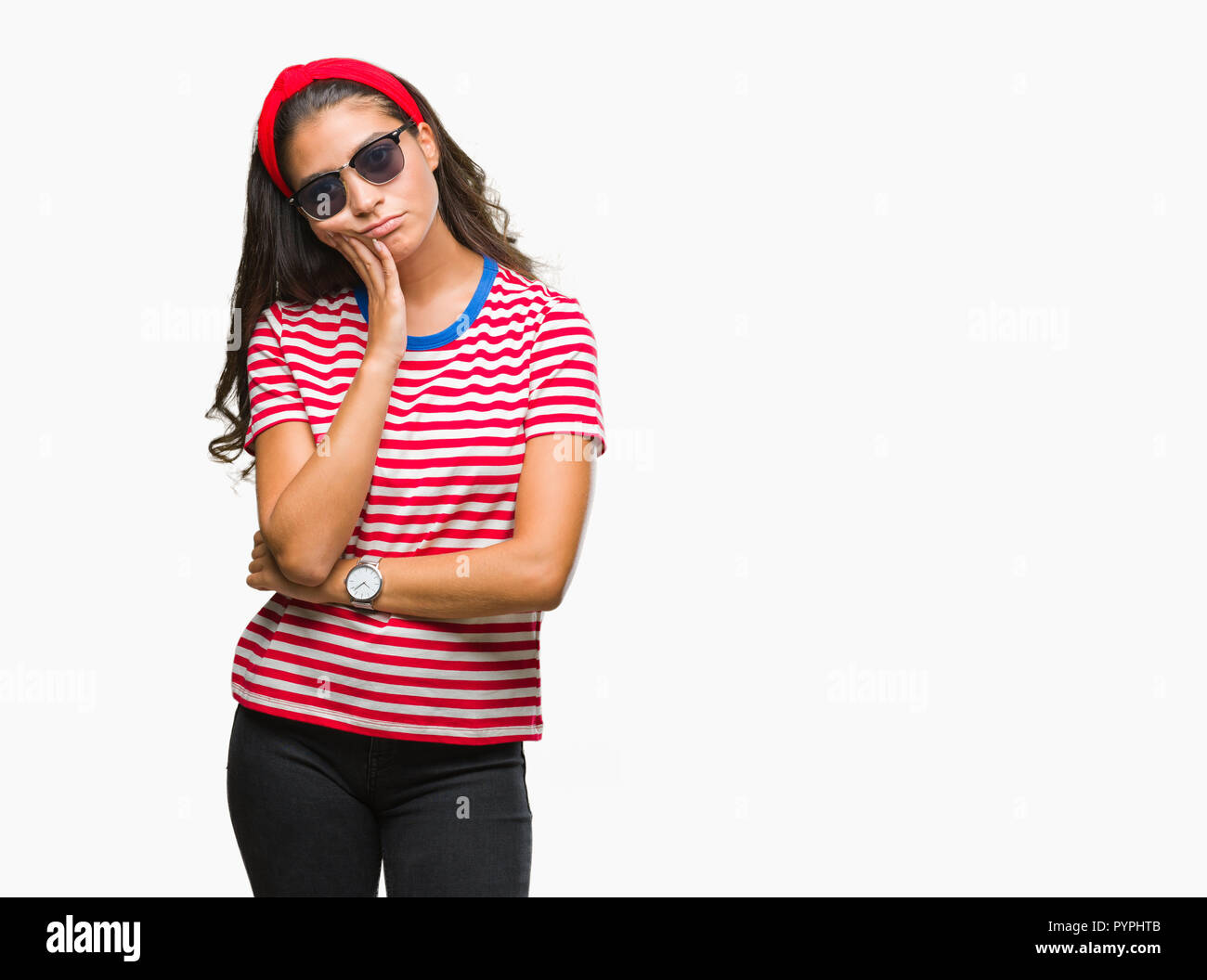 Young beautiful arab woman wearing sunglasses over isolated background thinking looking tired and bored with depression problems with crossed arms. Stock Photo