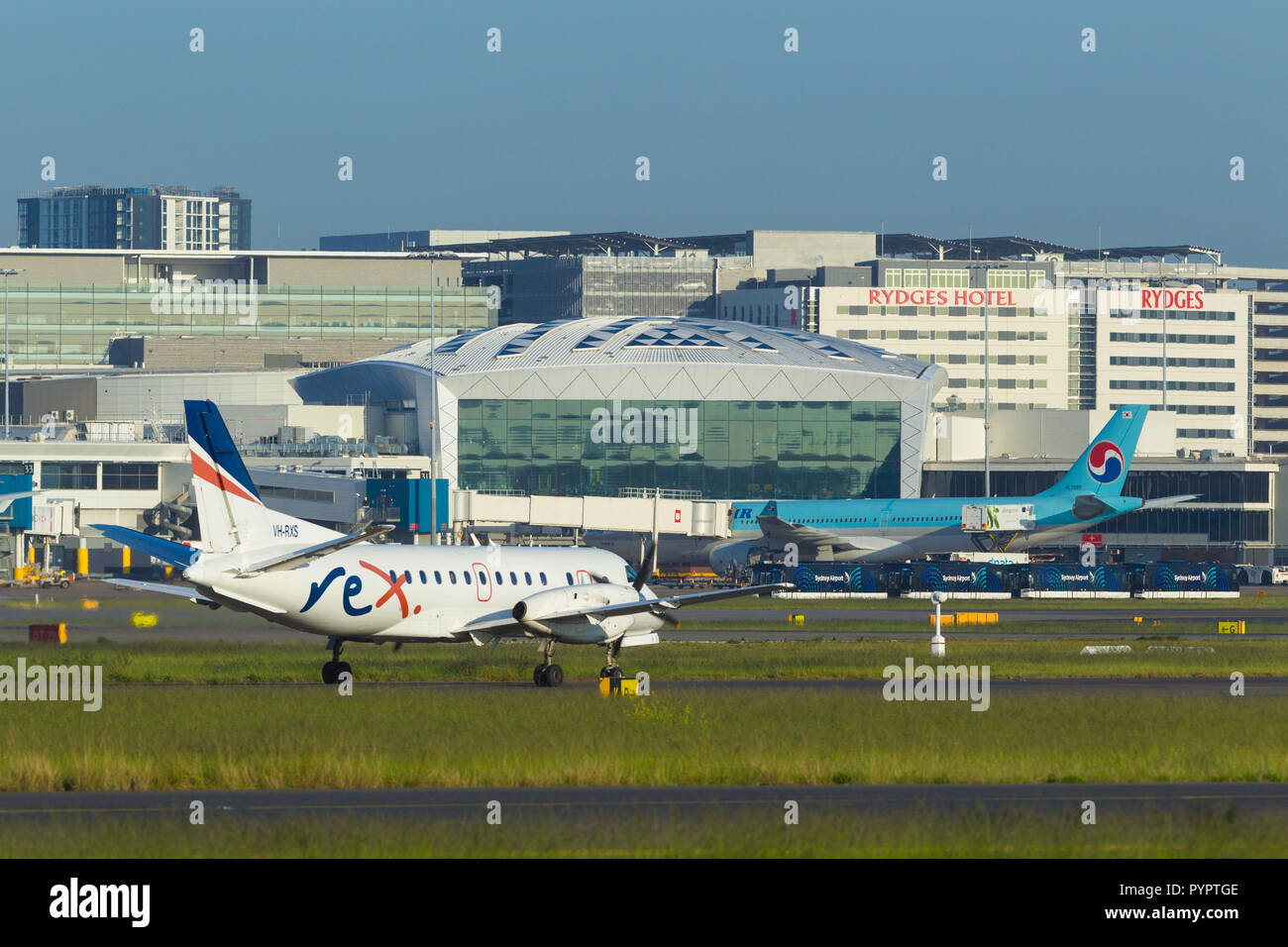 Detail from Sydney (Kingsford Smith) Airport in Sydney, Australia, looking towards the International Terminal on the western side of the airport. Pictured: The Rex VH-RXS (Regional Express) aircraft taxying. - Stock Image