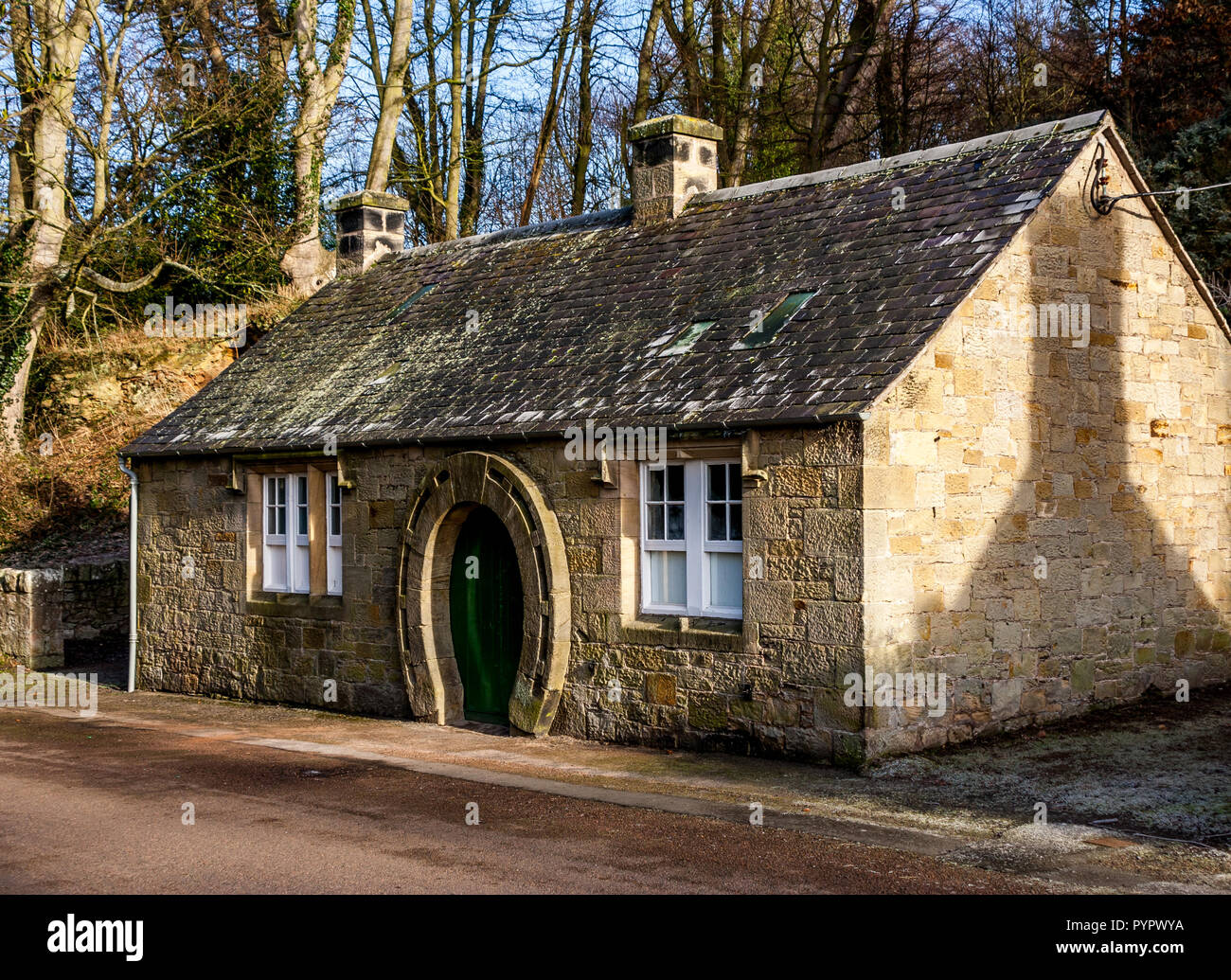 The old Blacksmiths Shop and Forge in Ford village on the Ford and Etal Estate in Northumberland. Note the horseshoe shaped door. Stock Photo