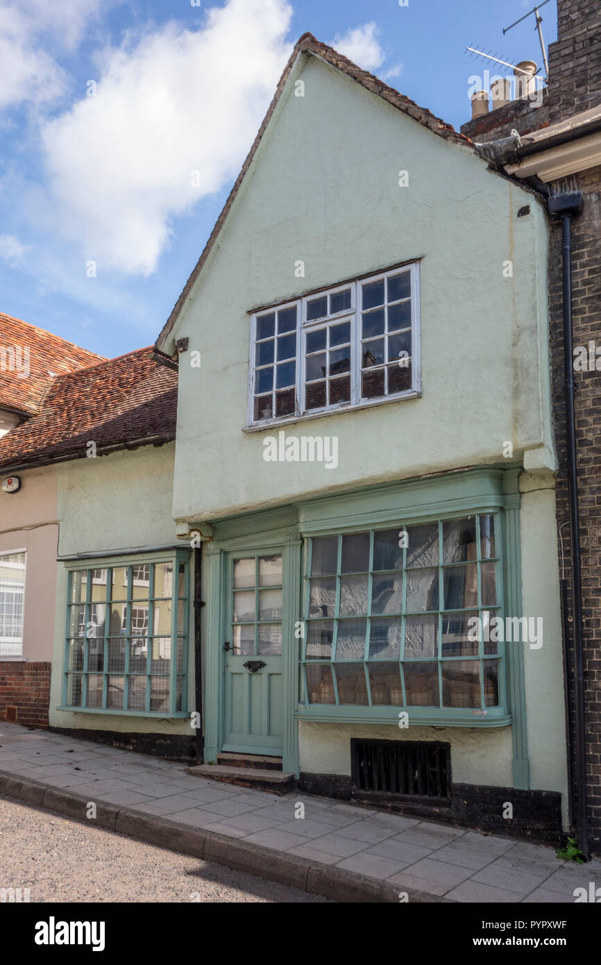 Building with an old bowed glass  window, Saffron Walden, historic market town in Uttlesford, Essex, UK - Stock Image