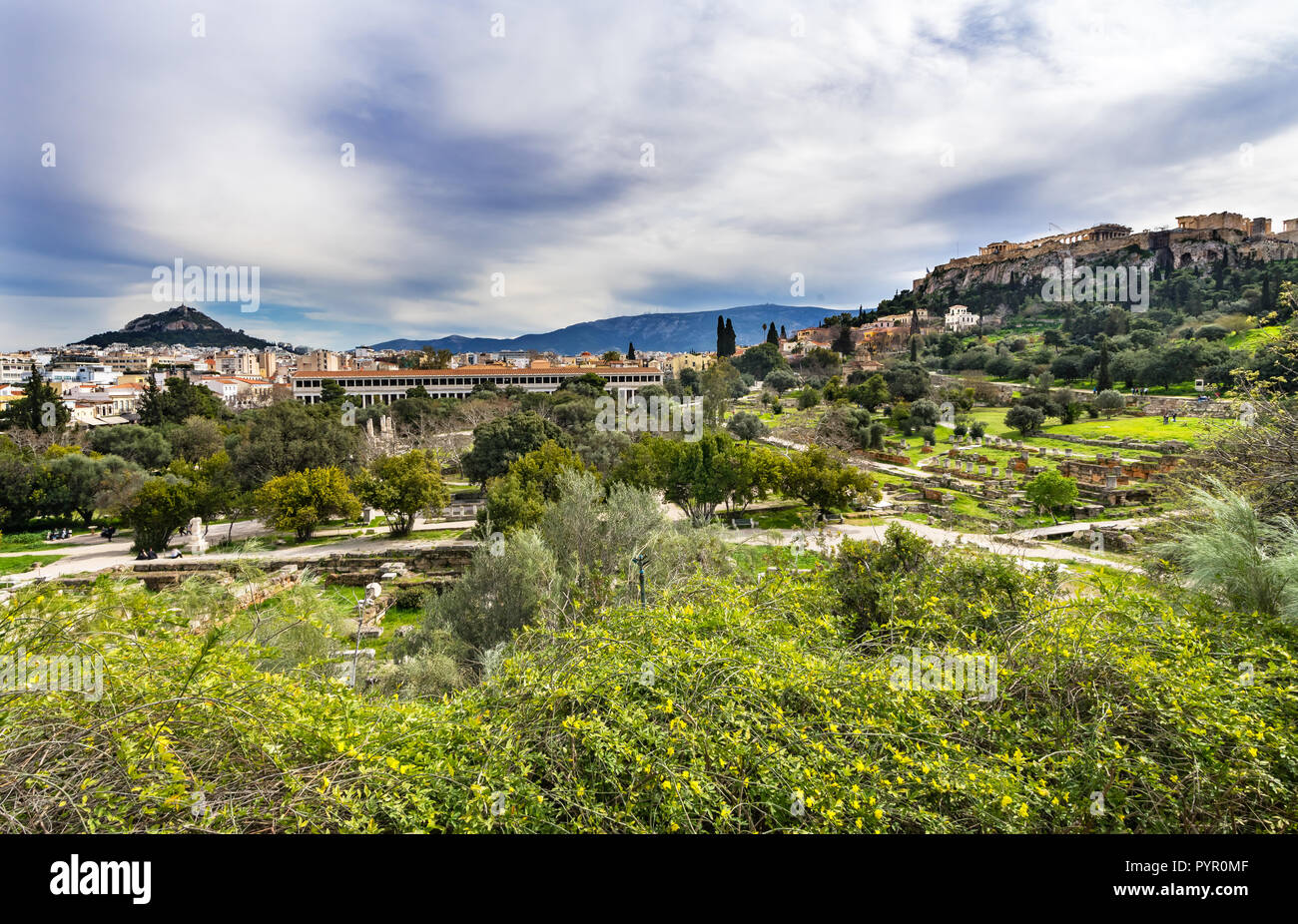 Ancient Agora Market Place Fields Stoa Attalos Parthenon Acropolis Athens Greece. Agora founded 6th Century BC, Parthenon built 438 BC symbol of ancie - Stock Image