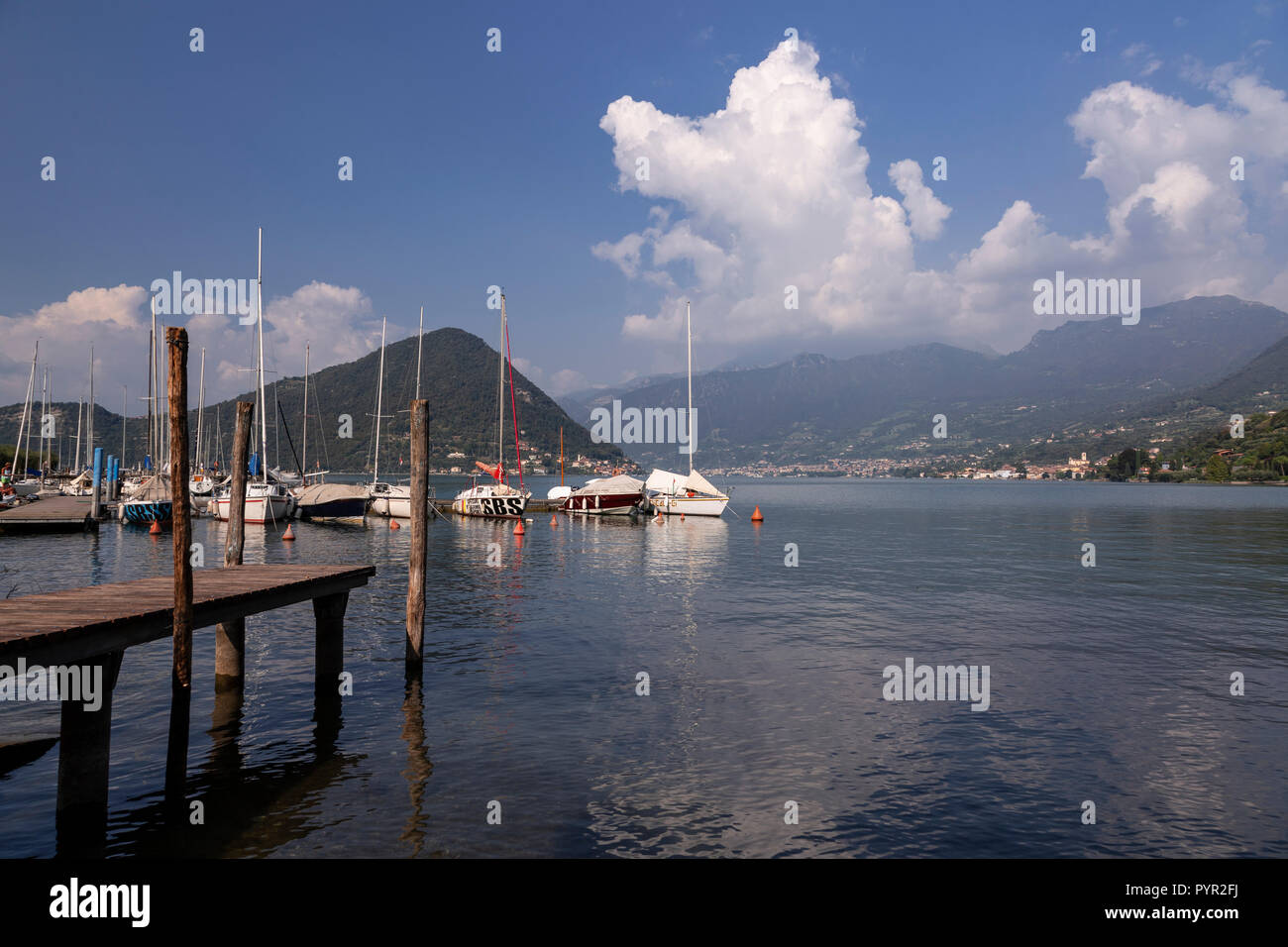 Boats moored on Lake Iseo in northern Italy - Stock Image