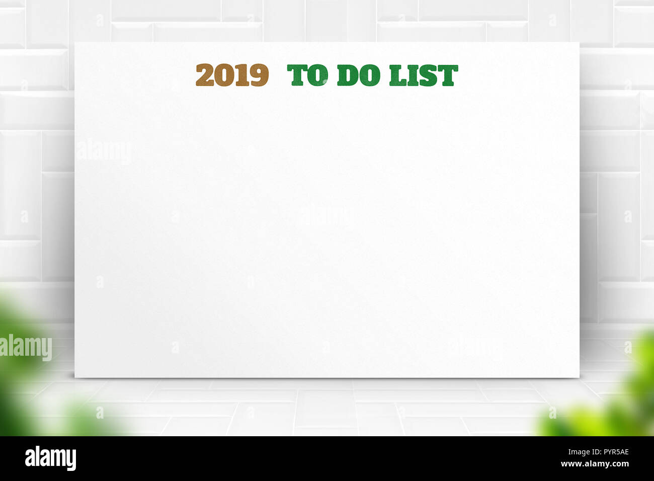 2019 new year to do list text on white paper poster and pencil with