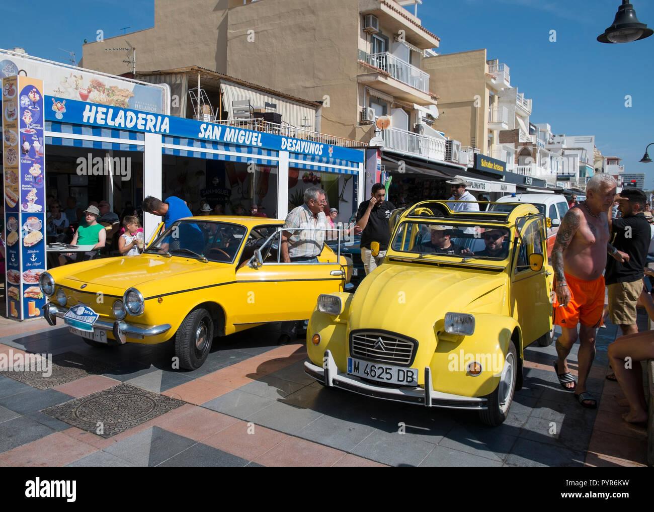 Fiat 850 Sport Coupe - Citroën 2CV. Classic car meeting in Torremolinos, Málaga, Spain. - Stock Image