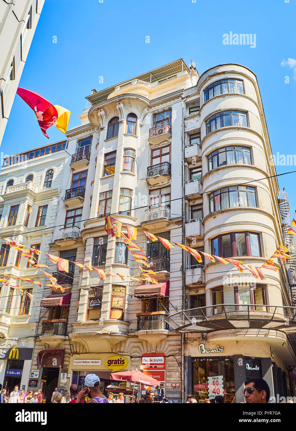 Bustling Istiklal street, adorned with pennants of the Galatasaray Sports Club. Beyoglu district. Istanbul, Turkey. - Stock Image