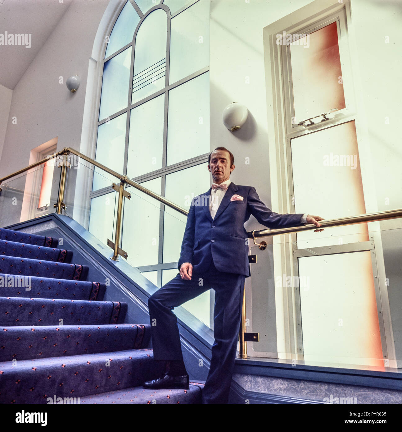 Swansea, Wales, Uk, May 1988: Manager of the Swansea Grand Theatre poses on the stairs of the foyer. Shot on medium format film. Stock Photo